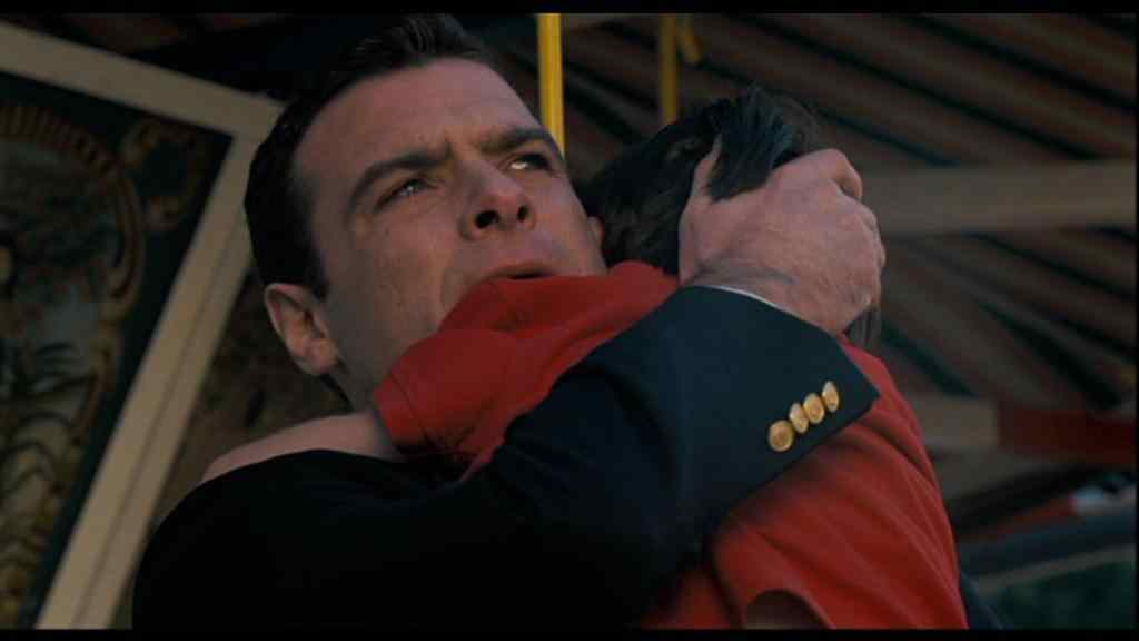 Damien gets a hug from his father played by Liev Schreiber in the remade 2006 Omen movie.