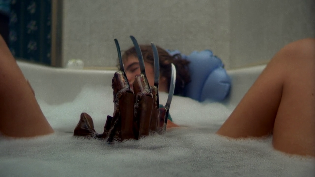 Nancy taking a bath and being joined by Fred Krueger in a scene from the epic slasher A Nightmare on Elm Street.