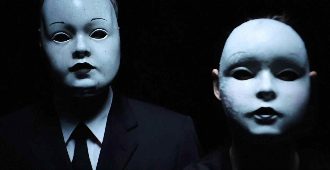 The masked killers from one of the possible scenarios in Drew Goddard's 2012 horror film The Cabin in the Woods.