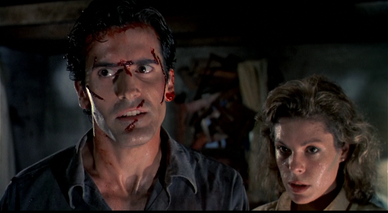 Ash (Bruce Campbell) and Annie (Sarah Berry) teaming up to fight evil in Sam Raimi's cult horror sequel Evil Dead II.