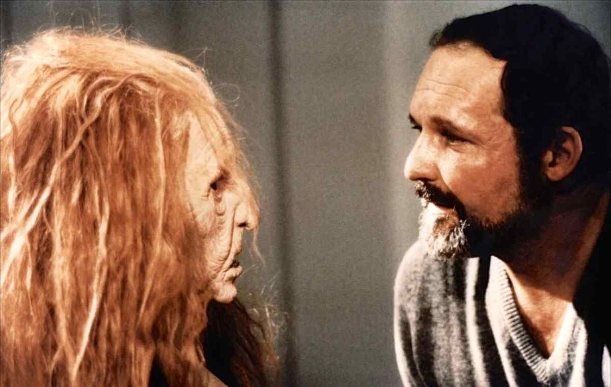 Jonathan Stryker (John Vernon) and one of his aspiring actresses in a hag mask.