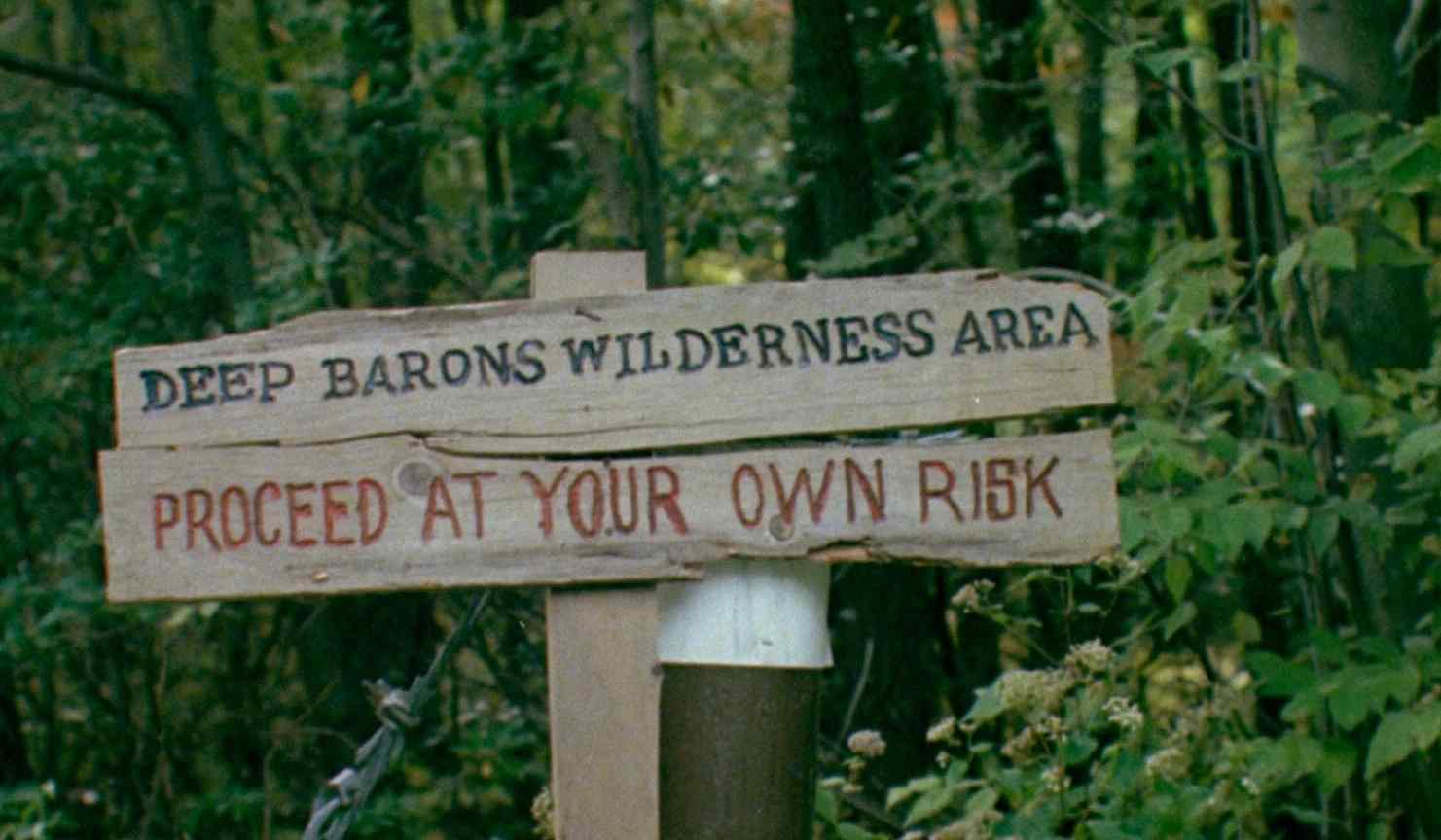 A warning in Charles Kaufman's revenge horror film Mother's Day 1980.