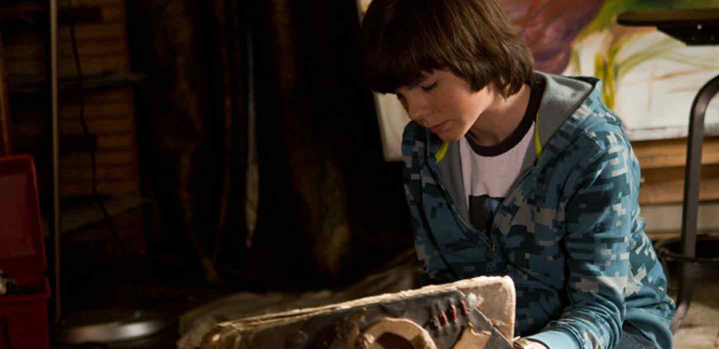 Chandler Riggs and ancient book in Mercy