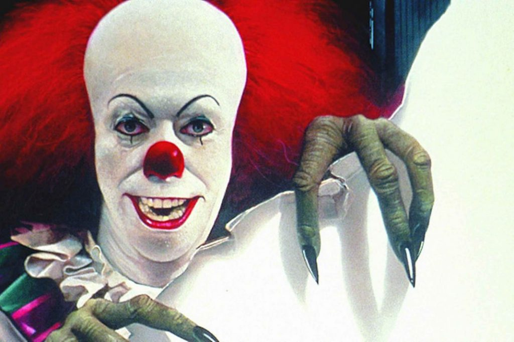 banner and poster art for stephen kings hit horror novel and mini series adaption IT.