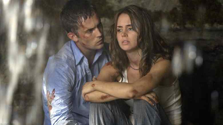 Chris and Jessie rest underneath a waterfall in Wrong Turn.