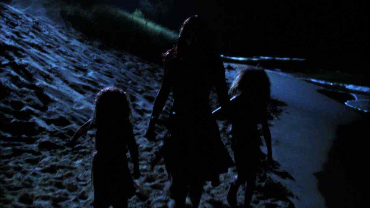 The cannibal family walks on the beach back to their cave in Offspring.