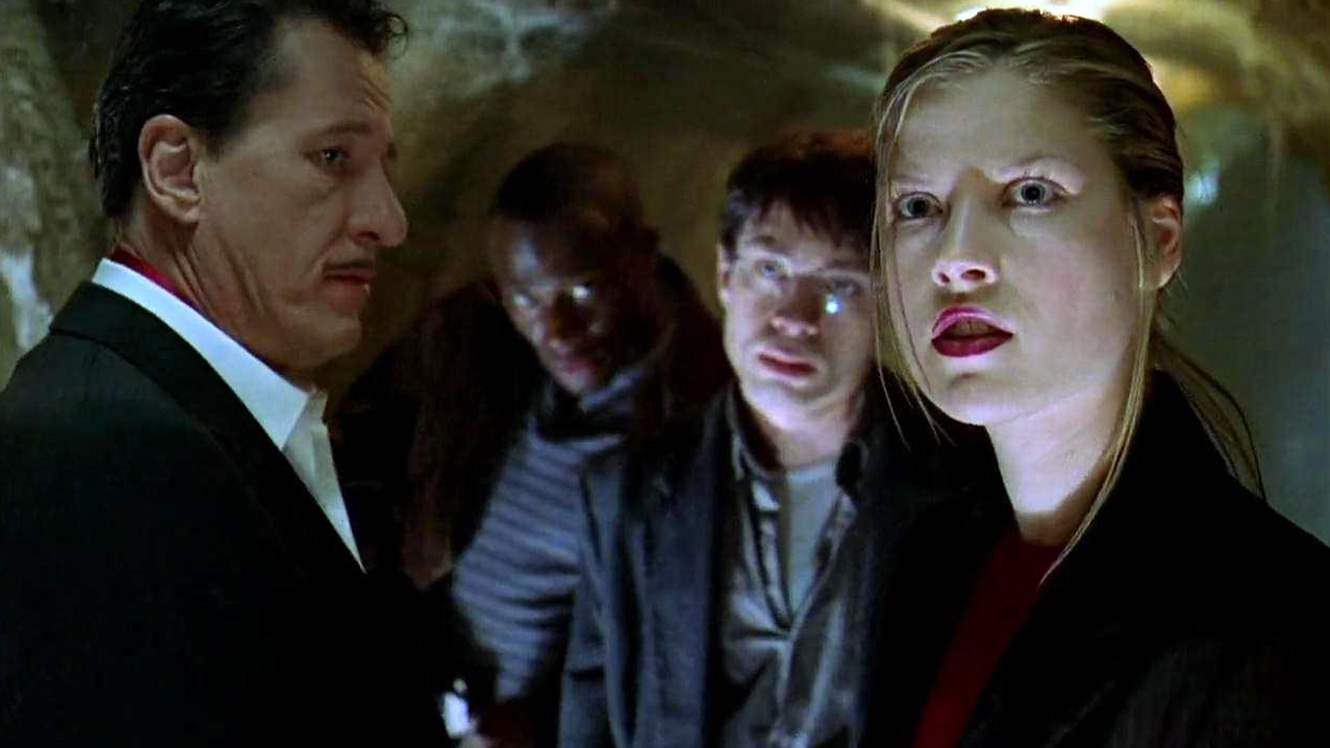 The characters navigate the house's labyrinthine basement to find an escape in House on Haunted Hill
