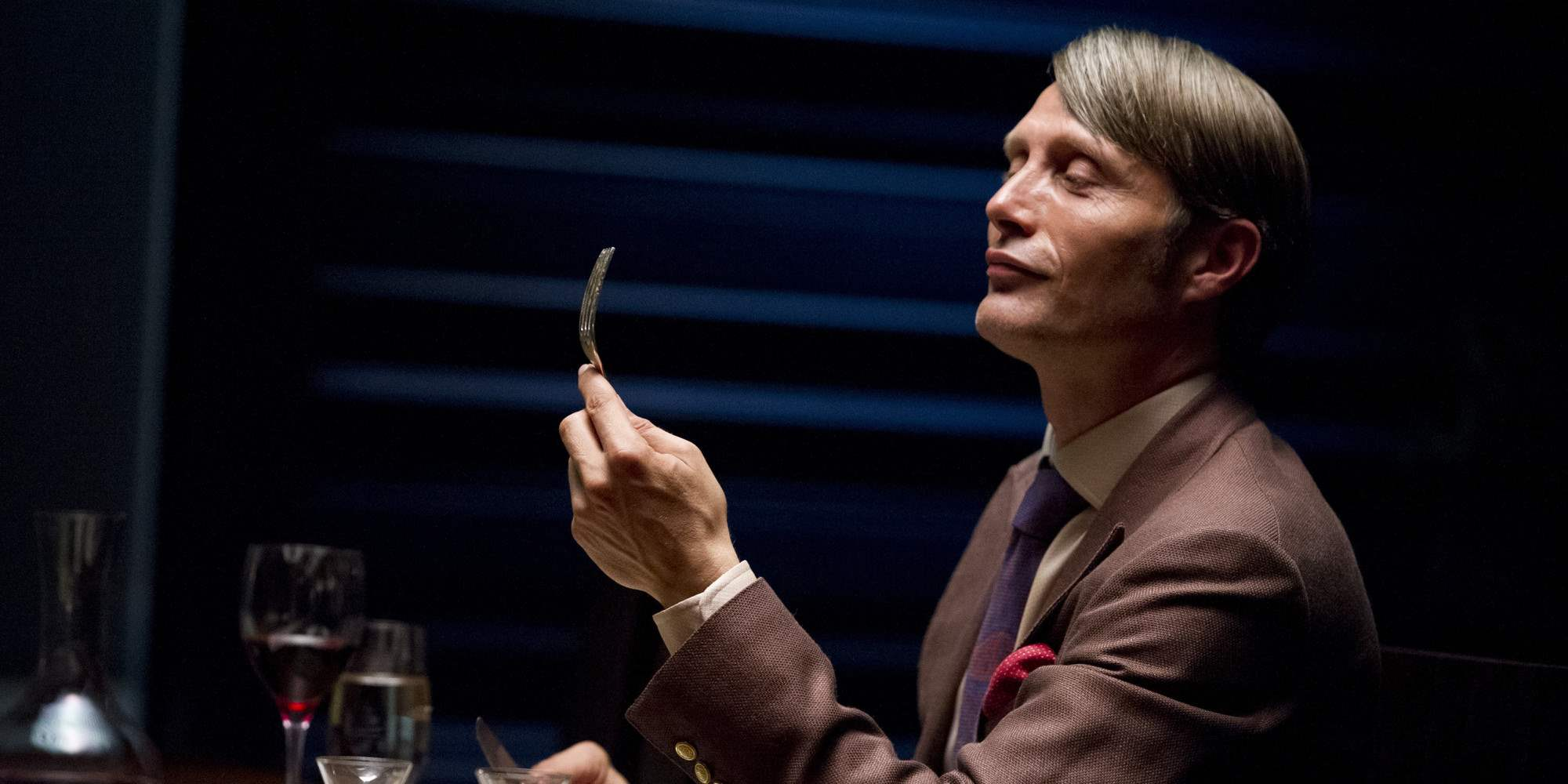 "Dr. Hannibal Lecter at the dinner table in NBC's show ""Hannibal"""