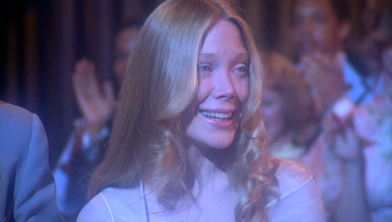 Carrie walking to the stage after being announced as prom queen.
