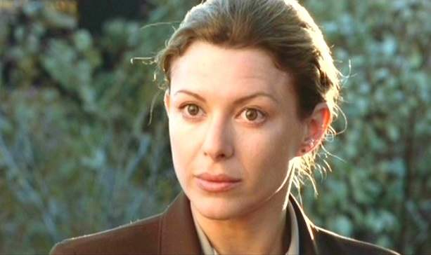 Kar Wuhrer portrays Sheriff Samantha Parker in the horror comedy Eight Legged Freaks