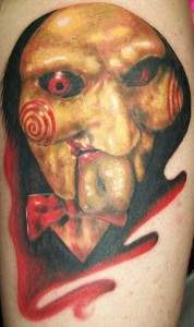 the saw movie puppet billy tattoo.