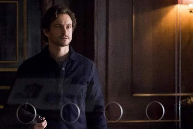 Will Graham approaches Hannibal Lecter's cell at the Baltimore State Hospital for the Criminally Insane.