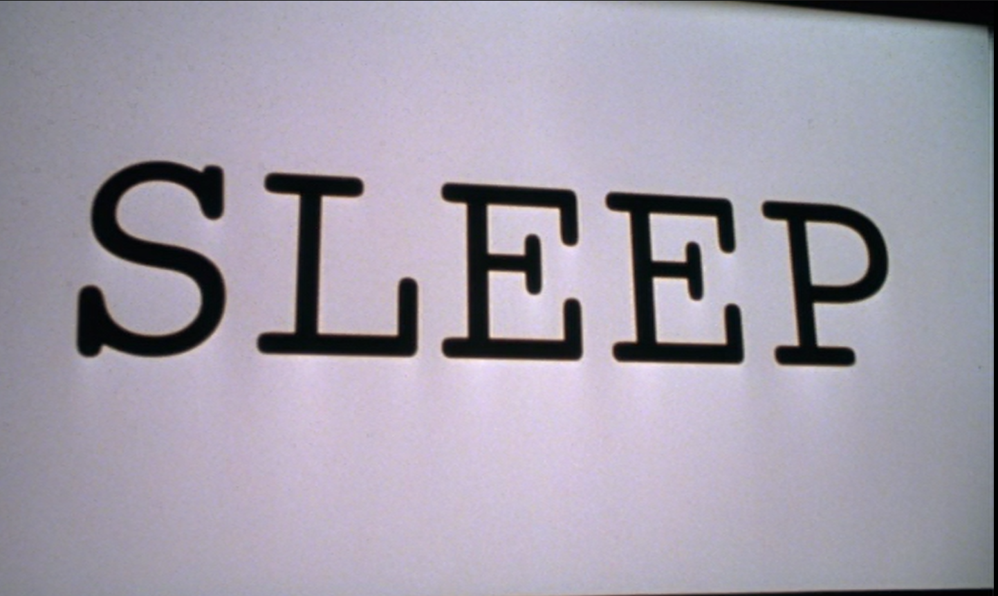 the word 'sleep' appears on the movie screen in Stir of Echoes