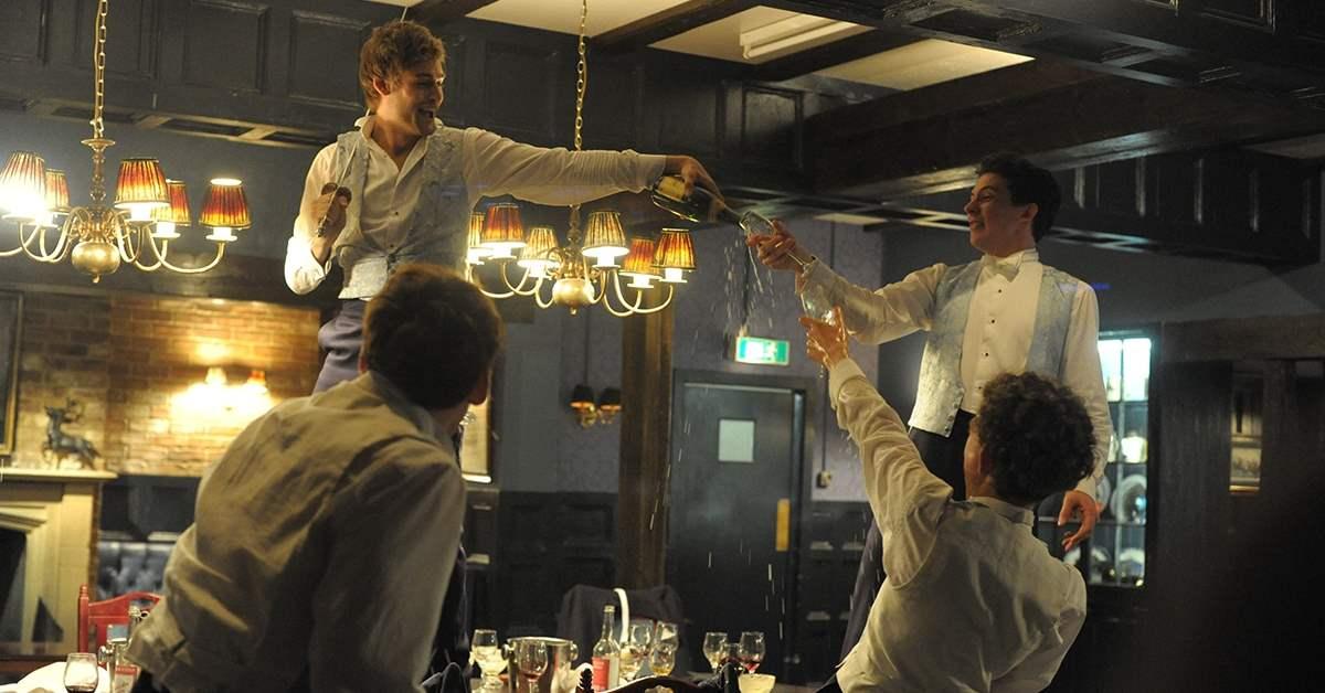Douglas Booth toasting in The Riot Club