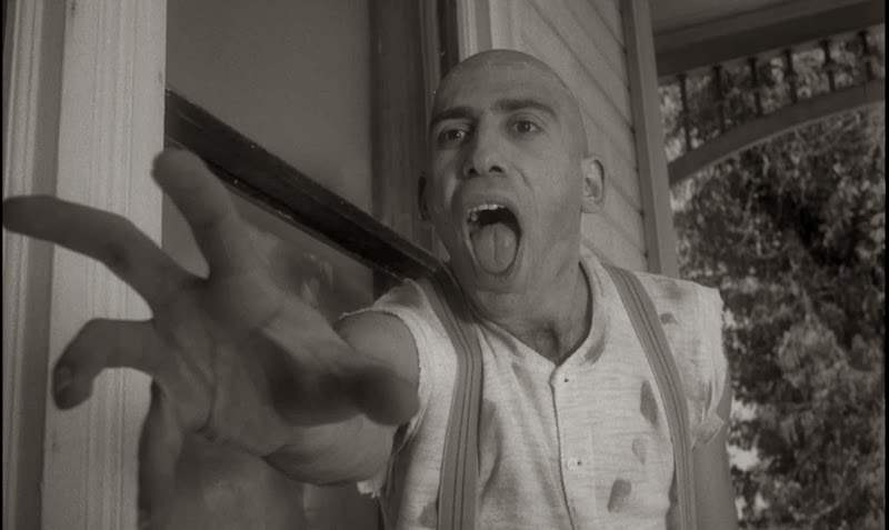 Sid Haig as Ralph reaches creepily for Carol Ohmart in Spider Baby