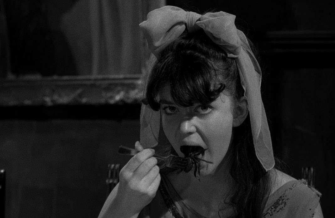 Viriginia eating a spider during the dinner scene in Spider Baby