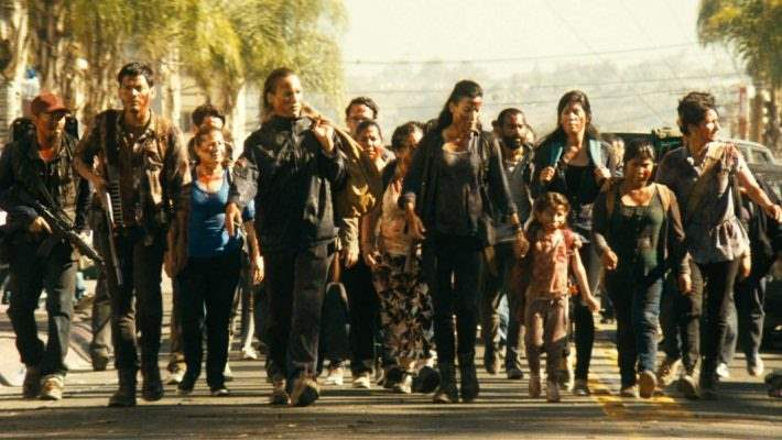 Danay Garcia as Luciana walks with several survivors in 'Fear the Walking Dead'