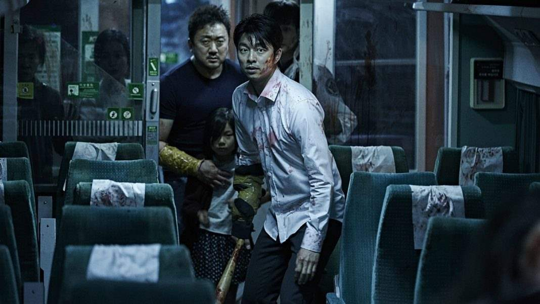 Passengers attempt to move through the hordes of zombies on the Train to Busan