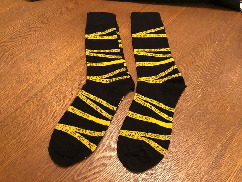 Crime scene tape socks in the December 2018 Creepy Crate