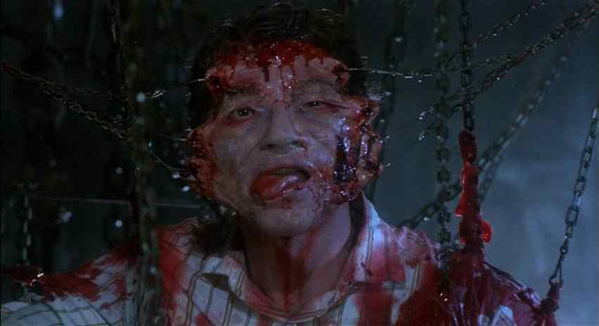 Frank in Hellraiser being ripped open by hooks in which afterwards he will spend eternity in hell with Pinhead and the cenobites.