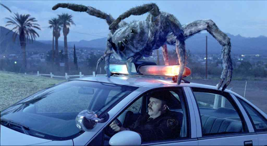 the movie poster for the film eight legged freaks, starring david arquette.