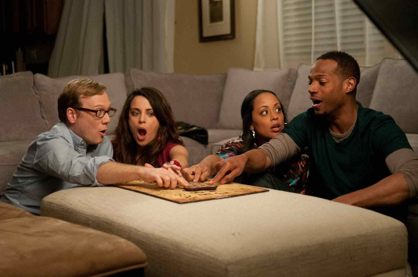 Malcolm and girlfriend Kisha and Jenny and Steve do an ouija board to try and contact the demon in a Haunted house directed by Michael Tiddes.