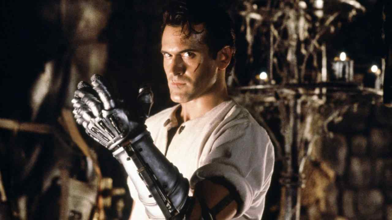 Ash (Bruce Campbell with a newly minted mechanical arm replacement/attachment in Sam Raimi's horror picture Army of Darkness.