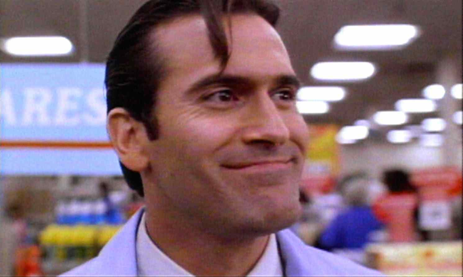 Ash (Bruce Campbell) as an S-Mart clerk in Sam Raimi's Army of Darkness.