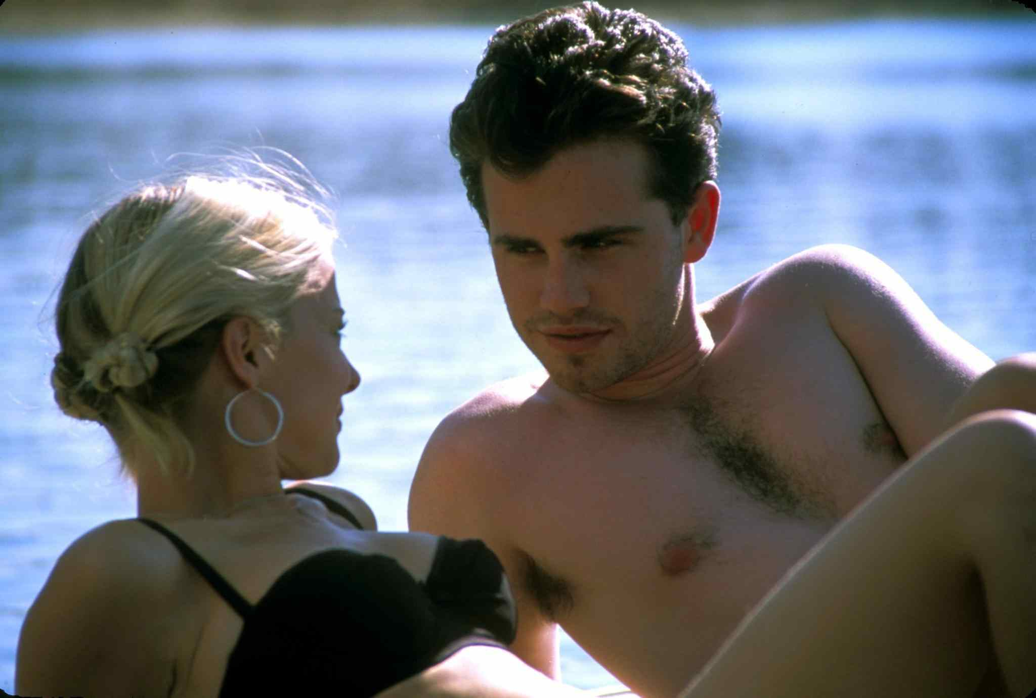 Paul (Rider Strong) and Karen (Jordan Ladd) on the dock in Eli Roth's 2002 horror film Cabin Fever.
