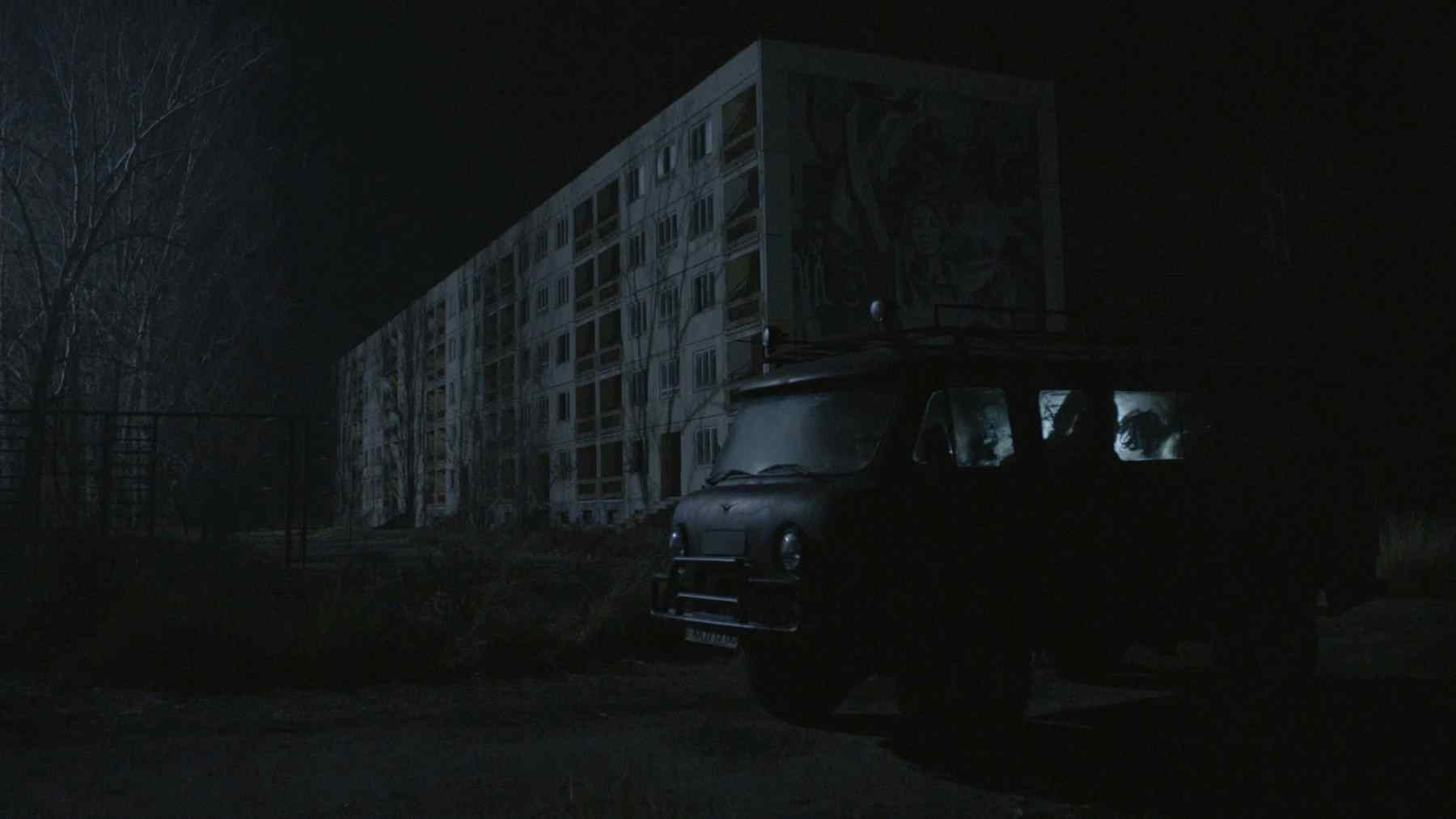 A movie still from the film Chernobyl Diaries directed by Bradley Parker.