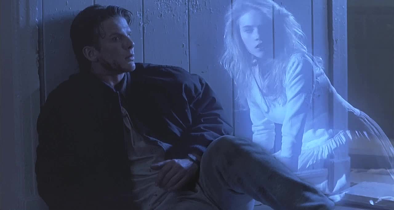 Alison (Cami Cooper) appears to Jonathan (Peter Berg) in Wes Craven's 1989 horror feature Shocker.