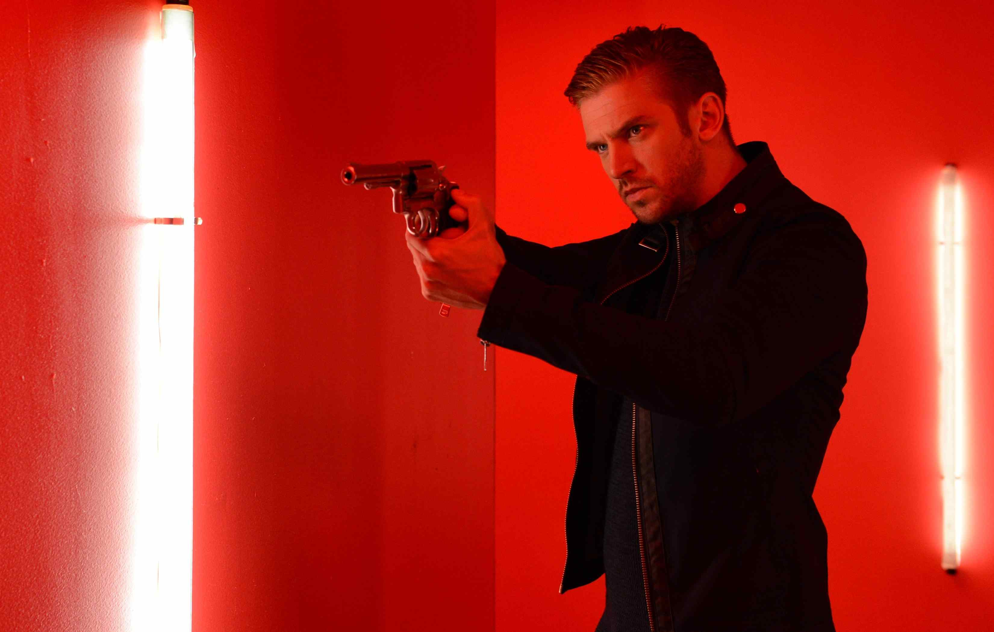 David (Dan Stevens) wields a gun in Adam Wingard's The Guest.