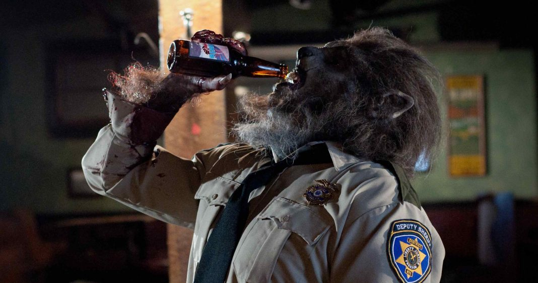 WolfCop (Leo Fafard) chugs a beer in this still from the upcoming Lowell Dean film WolfCop.