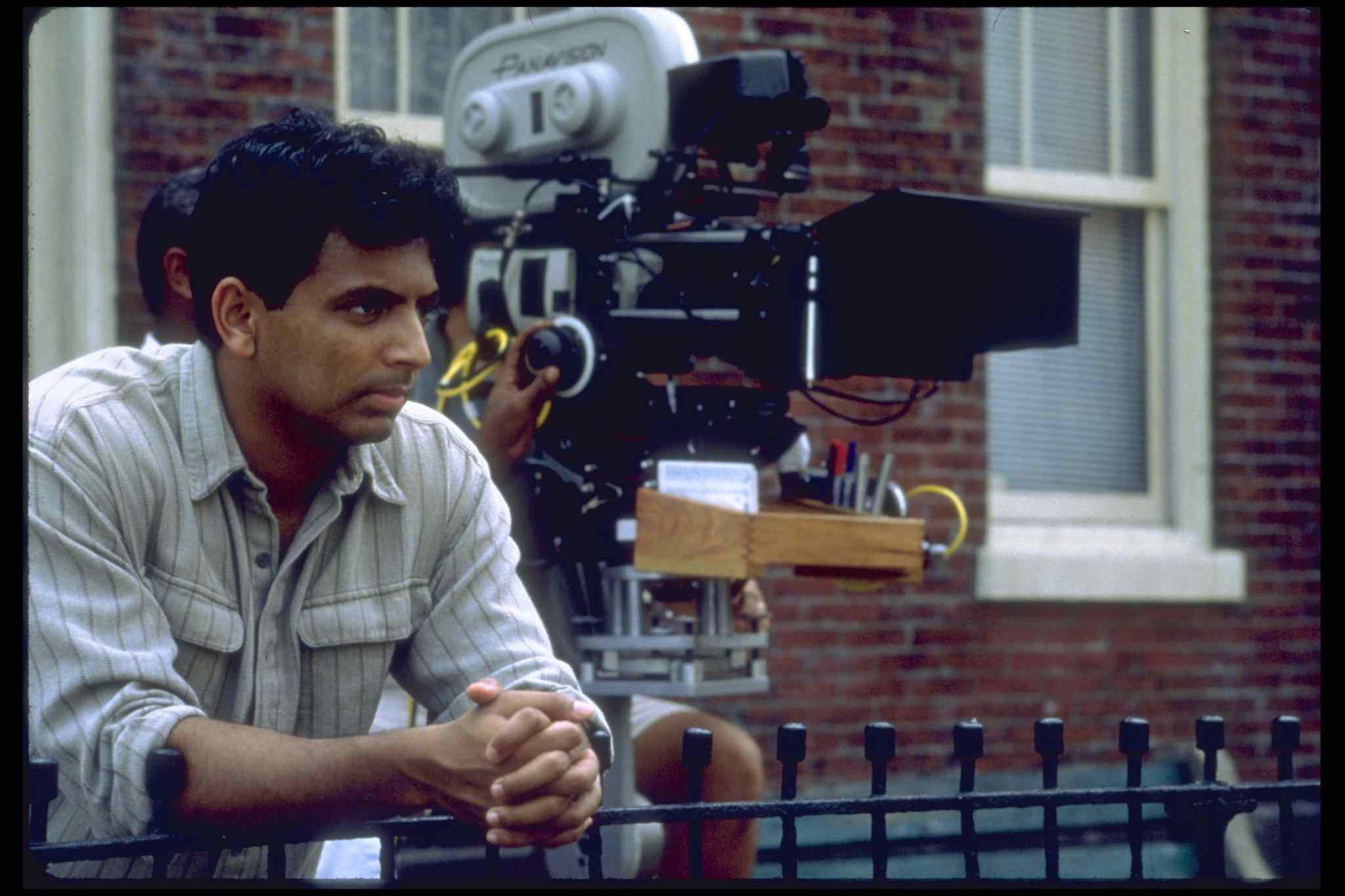 M Night Shyamalan hard at work directed his hit movies.