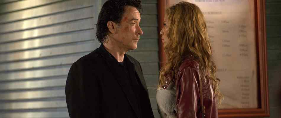 John Cusack and Rebecca Da Costa in Hitman.