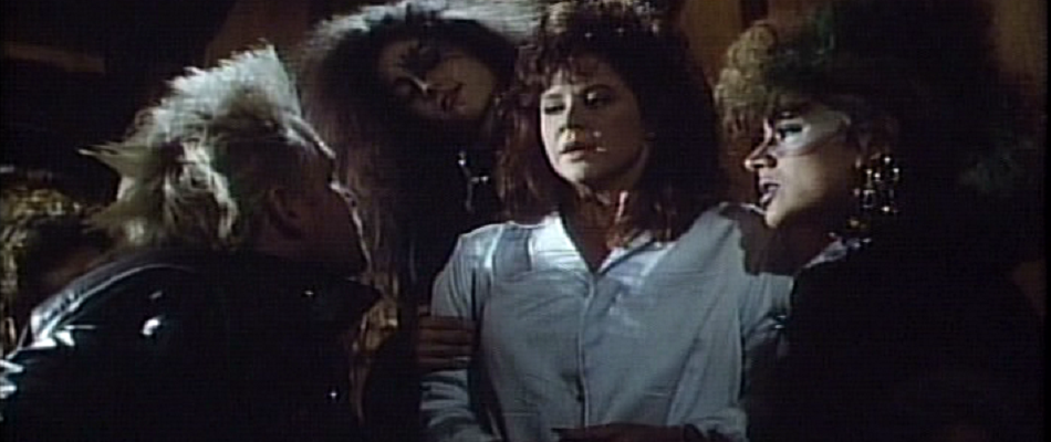Linda Blair being assaulted by punk rockers in Grotesque.