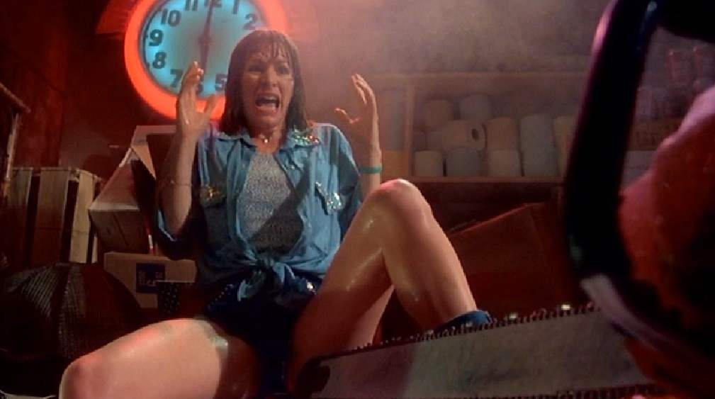 Stretch screaming at chainsaw between her legs.