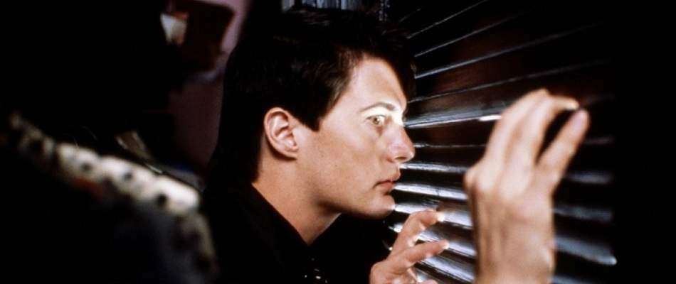 Kyle MacLachlan is suspicious in Blue Velvet.