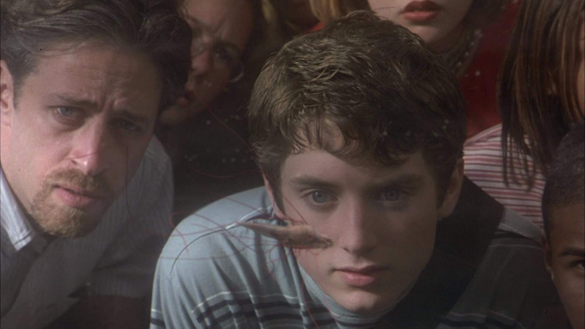 Elijah Wood and Jon Stewart in The Faculty