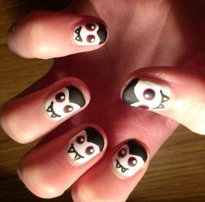 dracula fangs nail art.