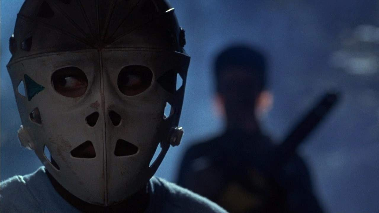 Angela dons a hockey mask in Sleepaway Camp 2