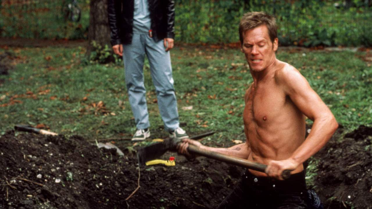 Kevin Bacon does some lawn maintenance in Stir of Echoes