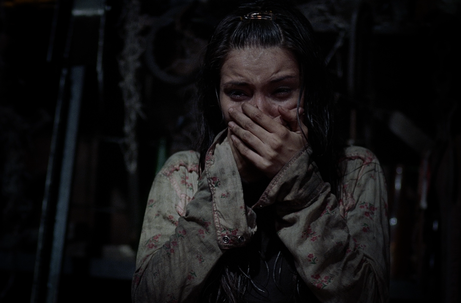 Marybeth (Tamara Feldman) cries after find the dead bodies of her father and brother in Hatchet.