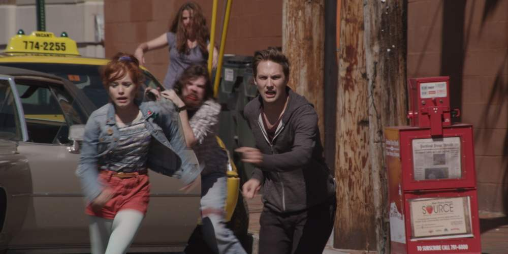 Maria Thayer and Michael Cassidy run for it in Night Of The Living Deb