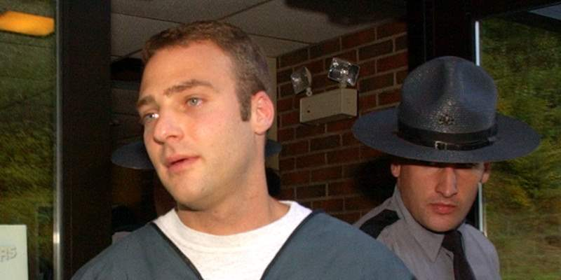 ** FILE ** Pennsylvania State police escort Hugo Selenski from his court appearance Oct. 6, 2003, in Kingston, Pa. Selenski, who had at least five sets of remains buried in his yard, was acquitted Wednesday, March 15, 2006 on several murder counts, but was convicted of abusing the corpses of two suspected drug dealers. (AP Photo/Bradley C. Bower)