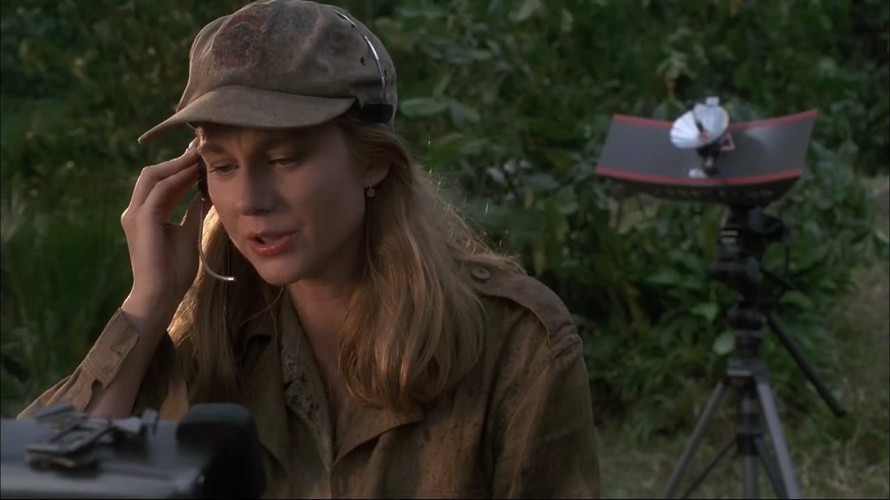 Karen communicates with her boss via satellite during her expedition in the Congo.