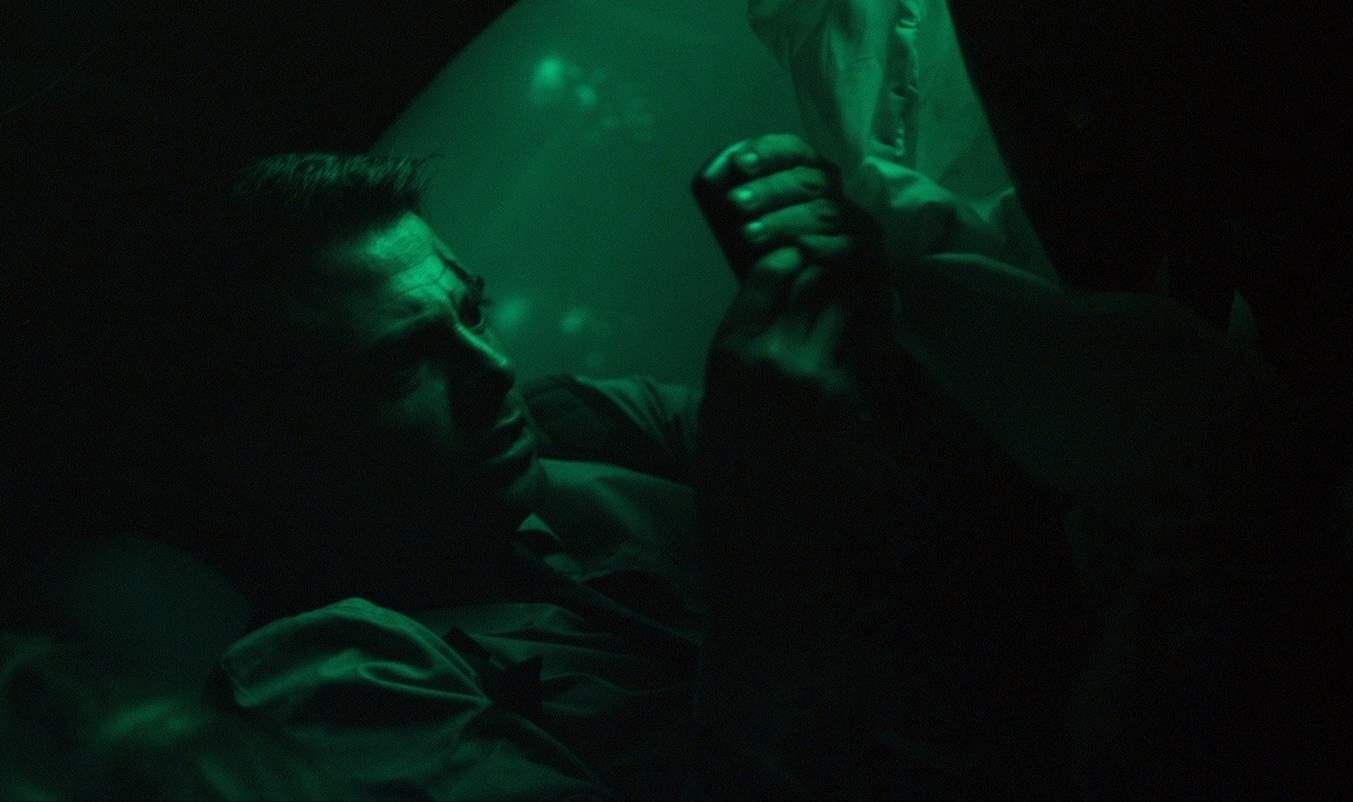 Jonathan Bennett as Matt tries to call for help in the underwater thriller Submerged.