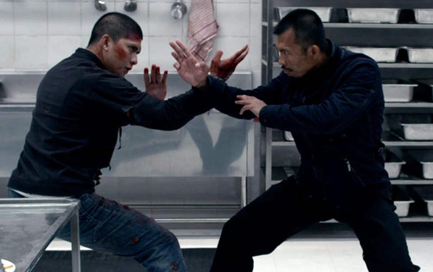 Rama and foe get into an epic an elaborate fight scene in a kitchen in The Raid 2.