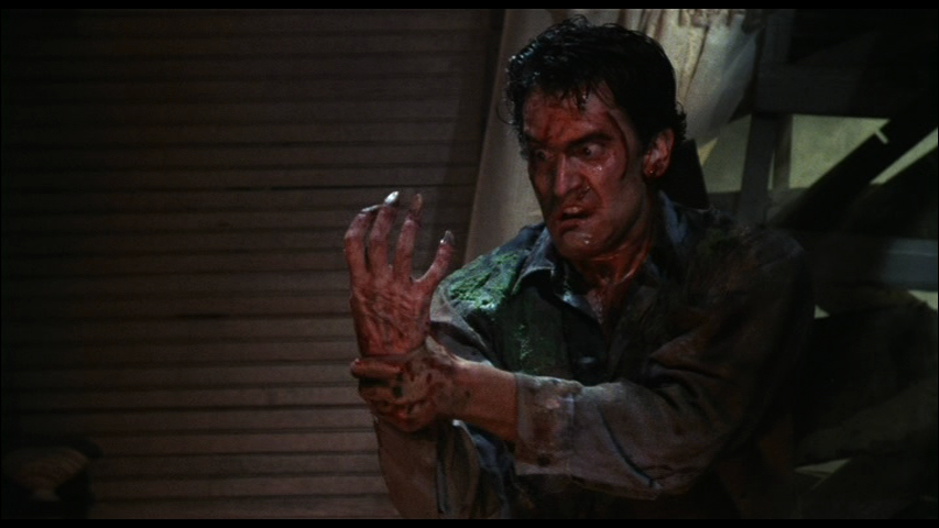 Ash and possessed hand in Evil Dead 2