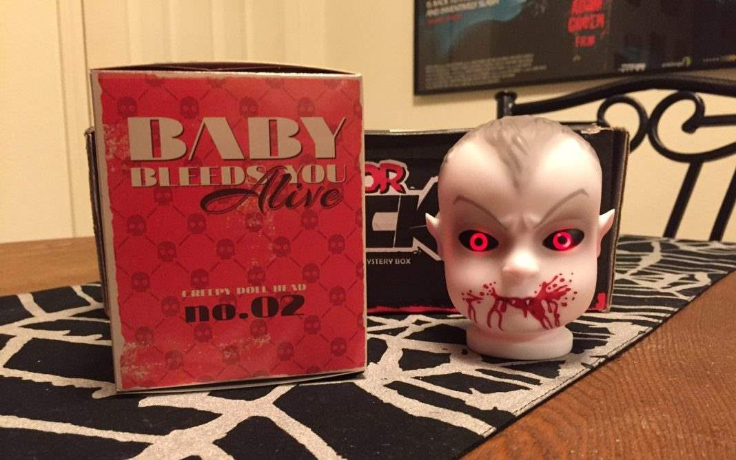 A light-up baby doll vampire head in the August 2016 Horror Block